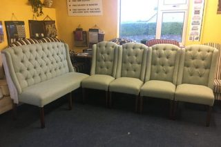 settle and upholstered chairs
